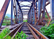 Antique train iron bridge over the river stock photography