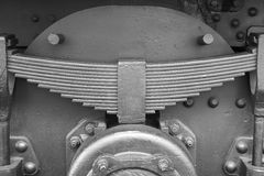 Antique train leaf springs detail in black and white. Horizontal stock photo