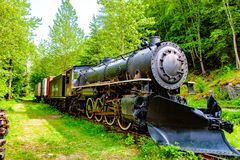 Antique Train. Skagway, AK, USA - May 26, 2016: WP&YR antique locomotive on display at the Skagway Museum royalty free stock photo