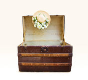 Antique travel trunk with straw hat Stock Photo