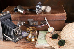 Antique traveller. Vintage tools of a traveller, compass, distance meter, suitcase and maps Royalty Free Stock Photo