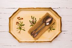 Antique tray with old cutlery. Spoon and fork  on white wooden background, view from above, flatlay Stock Photography