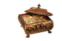 Antique Treasure Chest. Filled with Coins from all corners the world Stock Photography