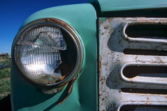 Antique truck grille and broken headlight Stock Photo