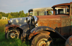 Antique Trucks in a Field. Rusted Antique Trucks parked in a field Royalty Free Stock Photos