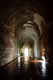 Antique tunnel. Heading to the light Stock Photo