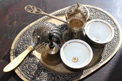 Antique turkish coffee set. On bronze platter with bell Stock Image