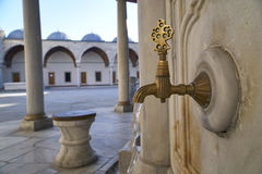 Antique Turkish faucet on wall Stock Image