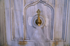 Antique Turkish faucet on wall Royalty Free Stock Photos
