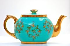 Antique Turquoise and Gold Teapot. This turquoise and gold teapot has been in my family for many generations.  This isolated object on white background is a rare Stock Image