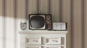 Antique TV set, alarm clock and radio on cabine Stock Photography