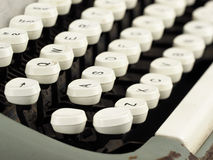 Antique type writer. With white keys and green body Royalty Free Stock Images