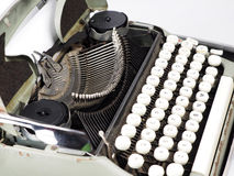 Antique type writer. With white keys and green body Royalty Free Stock Photos