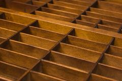 Antique Typesetter Drawer with Dividers Close Up Perspective Vie Royalty Free Stock Photography