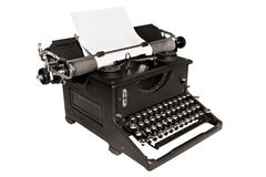 Antique Typewriter. Isolated on white, with blank paper.  Black and white image Royalty Free Stock Photos