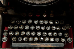 Antique typewriter. Antique black typewriter with round keys and a worn space bar Royalty Free Stock Images