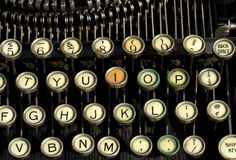 Antique Typewriter. Close up of antique typewriter's keyboard with discolored keys Stock Image
