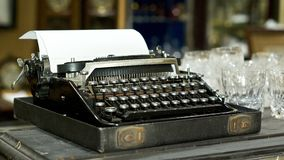 Antique typewriter. Old fashioned antique typewriter set up ready for the auction Royalty Free Stock Image