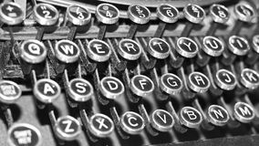 Antique typewriter. Old fashioned antique typewriter macro of keyboard with old fashioned typeface royalty free stock photos