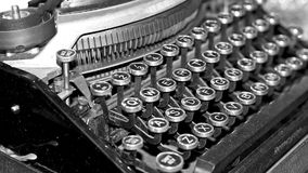 Antique typewriter. Old fashioned antique typewriter macro of keyboard with old fashioned typeface royalty free stock photography