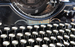 Antique typewriter from beginning 20th century at industry exhibit in an art gallery royalty free stock photo