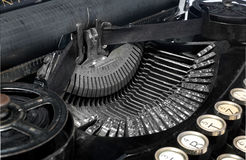 Antique typewriter, close-up photo mechanism. Antique typewriter, close-up photo mechanism, top view on a white background, view of the mechanism and view of royalty free stock image
