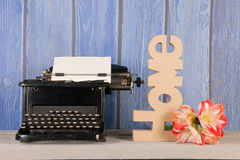 Antique typewriter with flower Royalty Free Stock Photography