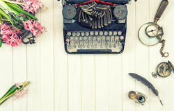 Antique typewriter flowers vintage office tools retro Royalty Free Stock Photography