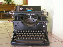Antique Typewriter. Manual antique Royal typewriter on tile counter Royalty Free Stock Image