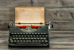 Antique typewriter with old textured paper page. Vintage style Royalty Free Stock Images