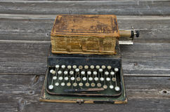 Antique typewriter with  old used book Bible Stock Photo