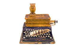 Antique typewriter with owl and old book isolated on white Stock Photography