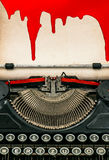 Antique typewriter and paper sheet with blood. Halloween concept Stock Photos