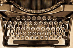 Antique typewriter on sepia. View of an antique manual Underwood typewriter on sepia stock image