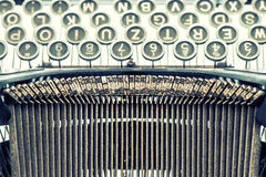 Antique typewriter. Vintage object. Retro style picture. Antique typewriter. Vintage object. Retro style toned picture Stock Photos