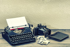 Antique typewriter and vintage photo camera royalty free stock photos