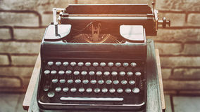 Antique typewriter. Vintage typewriter machine closeup retro styled. Royalty Free Stock Image