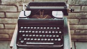 Antique typewriter. Vintage typewriter machine closeup retro styled. Stock Photos