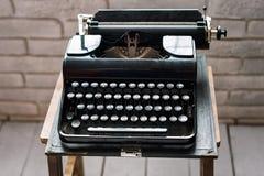 Antique typewriter. Vintage typewriter machine closeup retro styled. Stock Photography