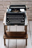 Antique typewriter. Vintage typewriter machine closeup retro styled. Royalty Free Stock Photo