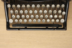 Antique typewriter on a wooden desk Royalty Free Stock Photos