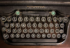 An antique typewriter on a wooden table Stock Image