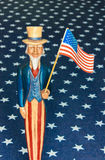 Antique Uncle Sam Figure Holding Old Glory royalty free stock photo