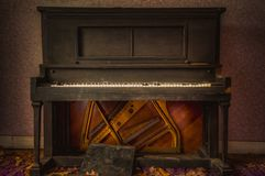 Antique Upright Piano. That was found in an abandoned building royalty free stock photos