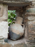 Antique urn in a stone wall Royalty Free Stock Images