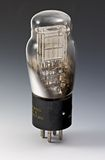 Antique vacuum tube. Type 71A with graduated grey background Stock Photography