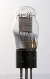 Antique vacuum tube. Side view against white background Stock Photos