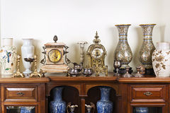 Antique vases and clocks. Various antique clocks vases and candlesticks on display royalty free stock images