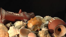 Antique vessels and sea shells stock footage