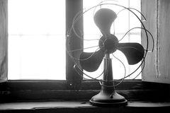 Antique vintage air fan. In the window backlight royalty free stock image